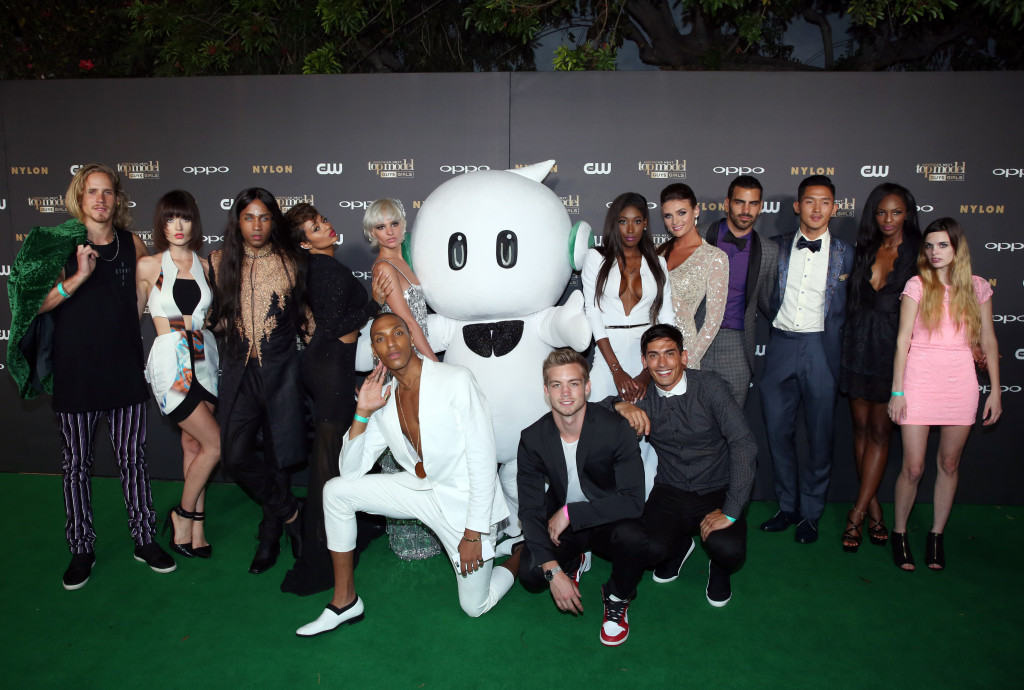 IMAGE DISTRIBUTED FOR OPPO - The 14 contestants of America's Next Top Model Cycle 22 pose on the 'green' carpet at the show's premiere party in Los Angeles on Tuesday, July 28, 2015.  OPPO, a leading global smartphone brand, is featured throughout ANTM's cycle 22 set to air in August on the CW network. (Photo by Matt Sayles/Invision for OPPO/AP Images)