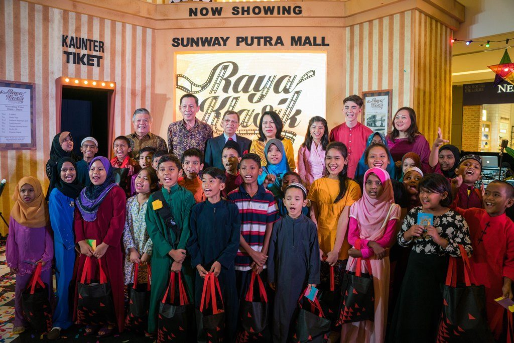 From the back, (left to right) Mr Kevin Tan, Mr H.C. Chan, Tan Sri Razman, Puan Sri Latiffah, Nik Qistina, Greyson Chance and Ms Phang Sau Lian, together with the children of Yayasan Chow Kit.- S